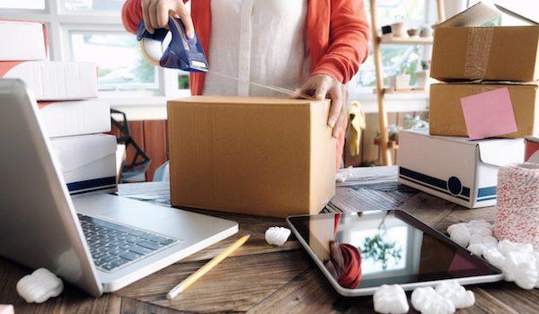 lady taping a box